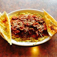 Special: Spaghetti with Italian sausage marinara and garlic bread.
